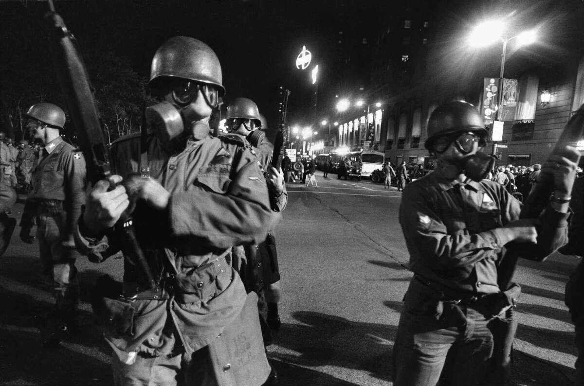 National Guard troops in gas masks posted outside the Democratic National Convention in Chicago, Aug. 28, 1968.