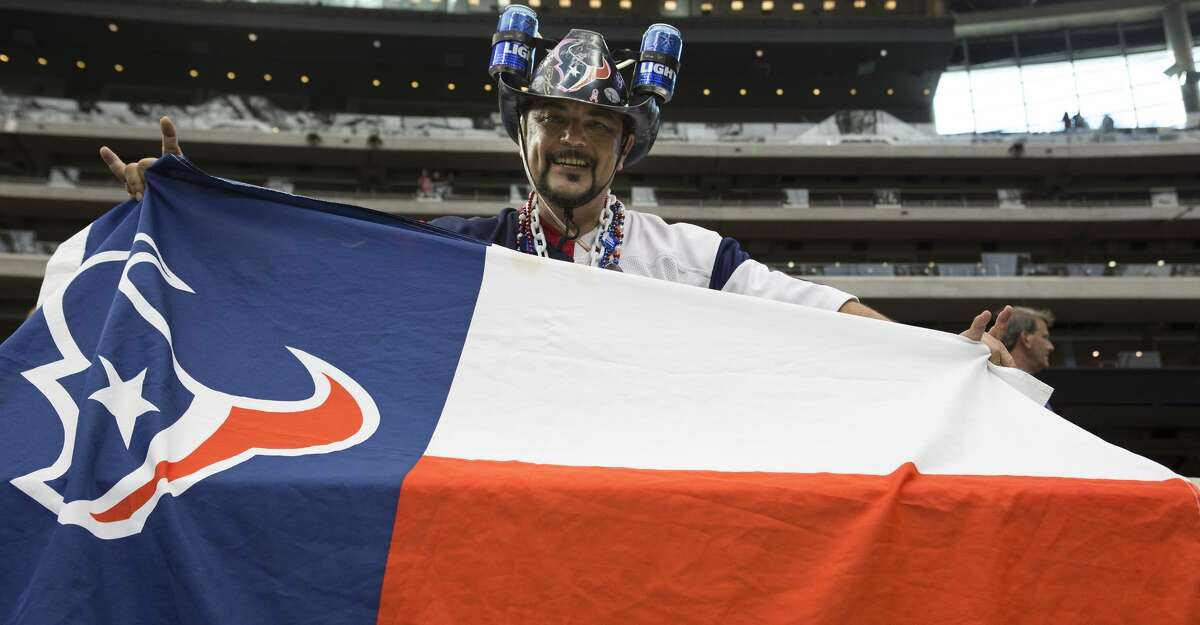Football fans watch warm ups before an NFL preseason football game between the Houston Texans and the Dallas Cowboys at NRG Stadium on Thursday, Aug. 30, 2018, in Houston.