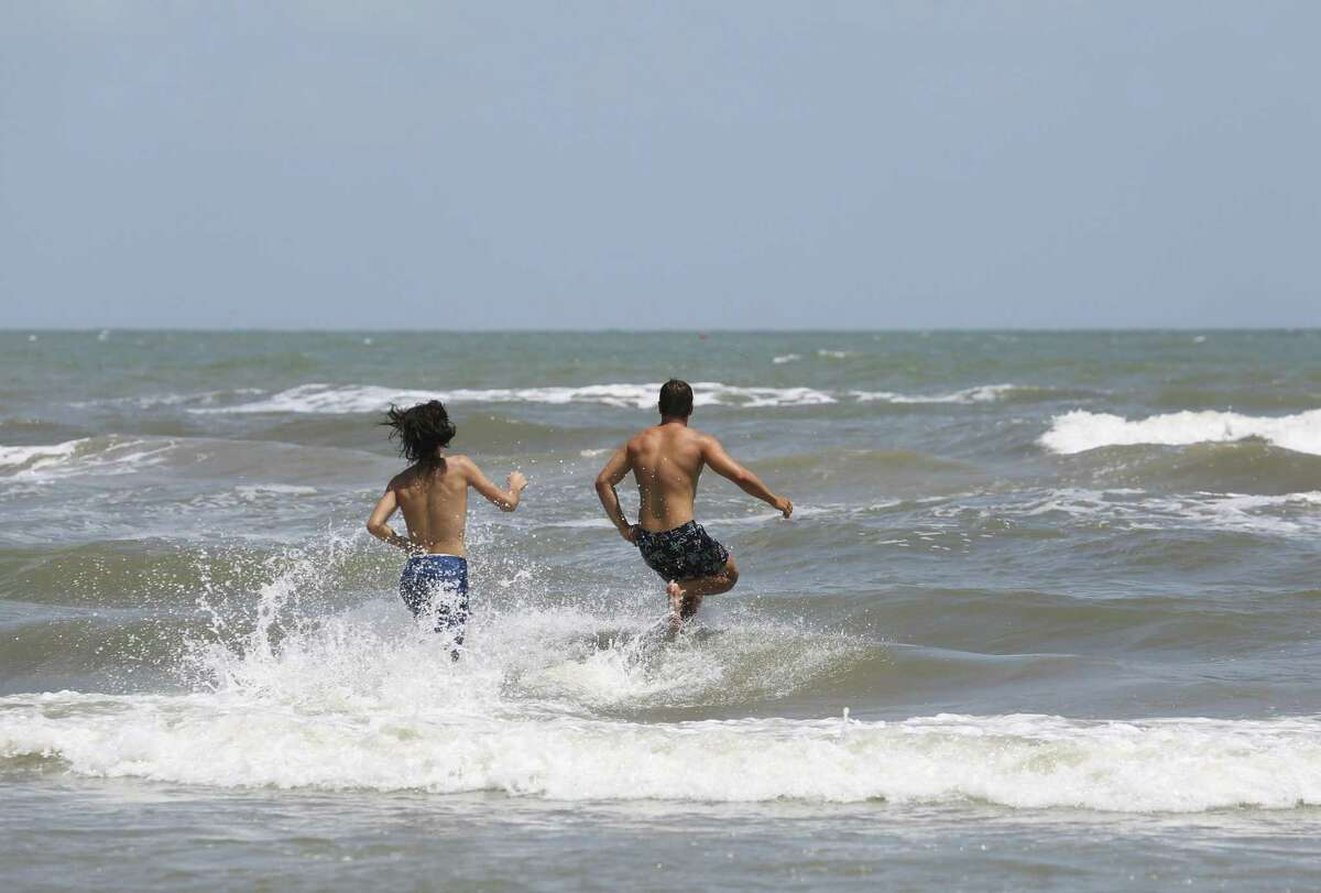 People enjoy a summer day in Galveston in this June 2018 file photo. A new report issued Thursday, Aug. 30, 2018, by Environment Texas says Galveston's water contains bacteria that could cause illnesses.