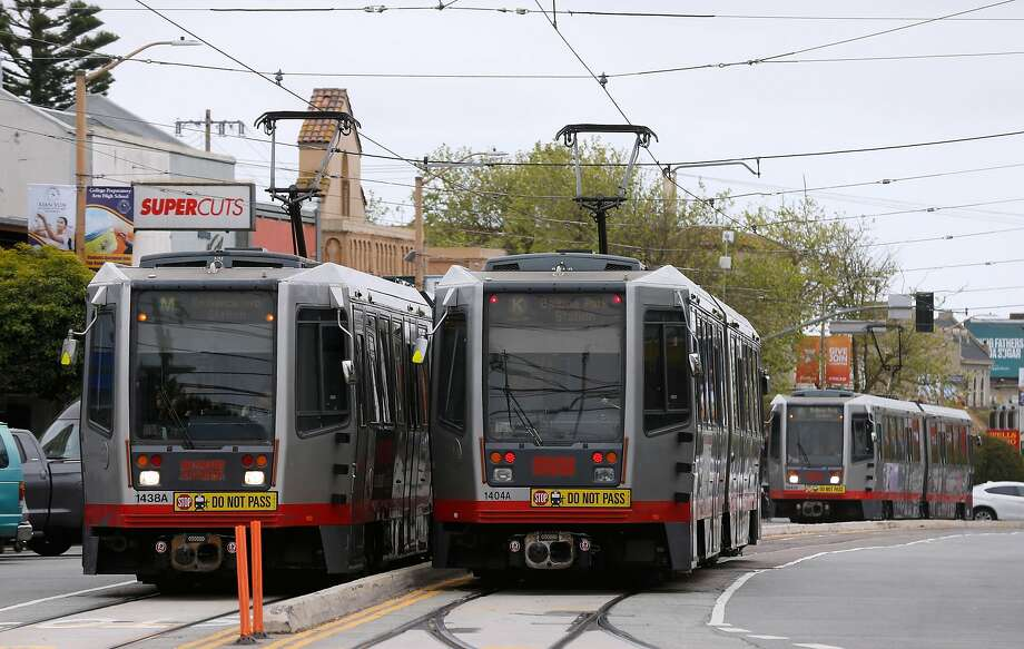 This file photo shows Muni Metro streetcars traveling up and down West Portal Avenue in San Francisco, Calif. on Thursday, April 5, 2018. A bus collided with a Muni train just before 9:30 a.m. Friday near the intersection of Mission Rock and Third streets in San Francisco, officials said. Photo: Paul Chinn / The Chronicle