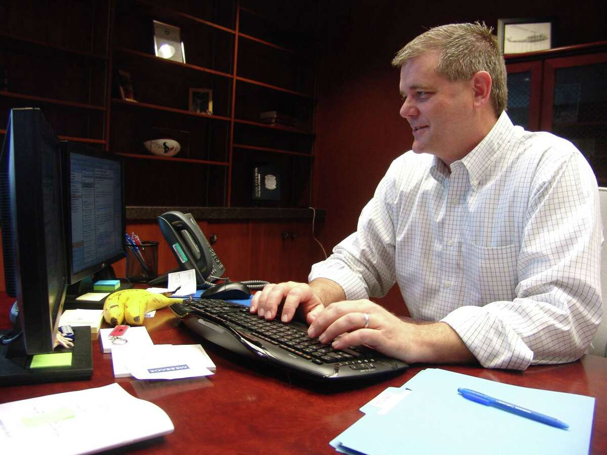 File photo shows Galveston County Judge Mark Henry working at his Galveston Island office.