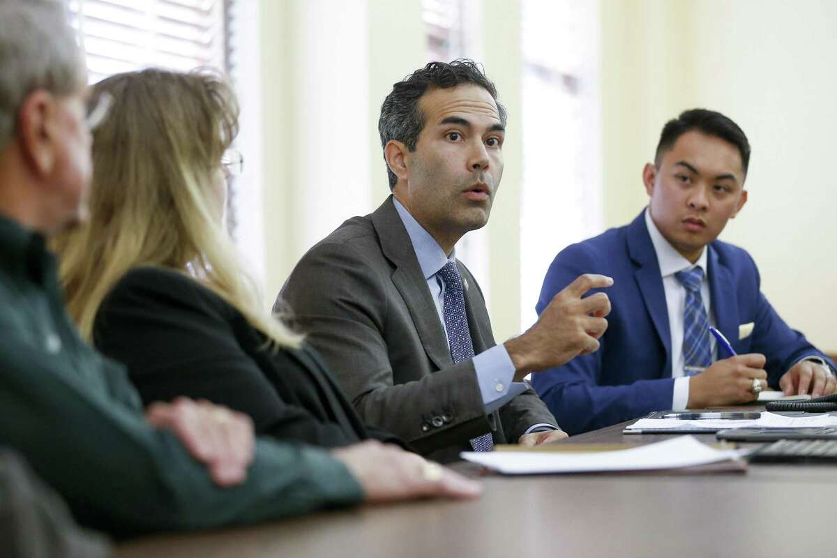 Texas Land Commissioner George P. Bush, second from right, talks to Fort Bend County representatives and representatives from cities in Fort Bend County during a roundtable discussion about the state of housing recovery after Hurricane Harvey at the Historic Courthouse Tuesday, Nov 28, 2017 in Richmond.