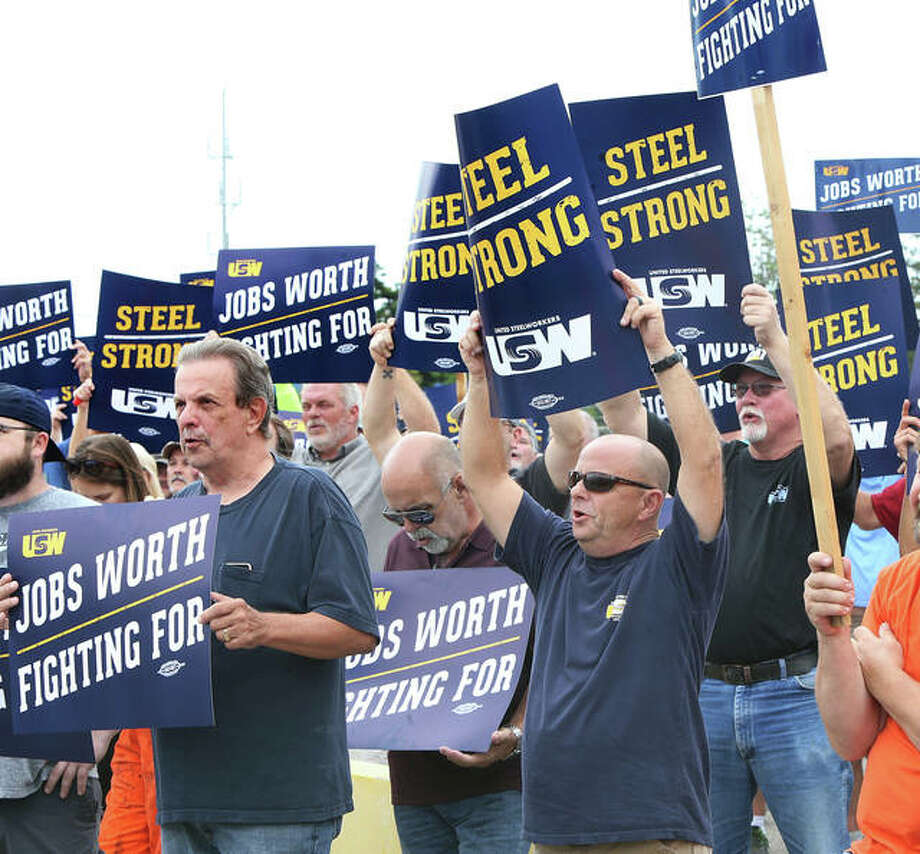 Some of the more than 200 union members who attended a rally Thursday outside the Nash Street gate at U.S. Steel-Granite City Works hold signs and repeat chants from union officials. The union is currently negotiating in Pittsburgh with a contract set to expire on Saturday if no deal is reached. See additional photos of the rally at TheTelegraph.com. Photo: John Badman | The Telegraph