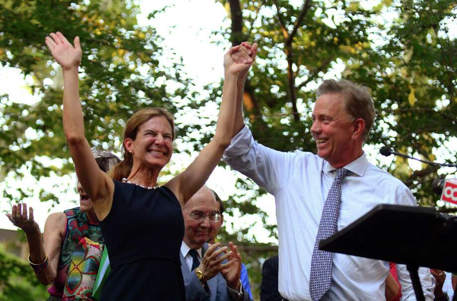 Susan Bysiewicz and Ned Lamont, Democratic candidates for lieutenant governor and governor, respectively, wave to the crowd at a unity rally at Wooster Square Park in New Haven Thursday. Photo: Christian Abraham / Hearst Connecticut Media / Connecticut Post