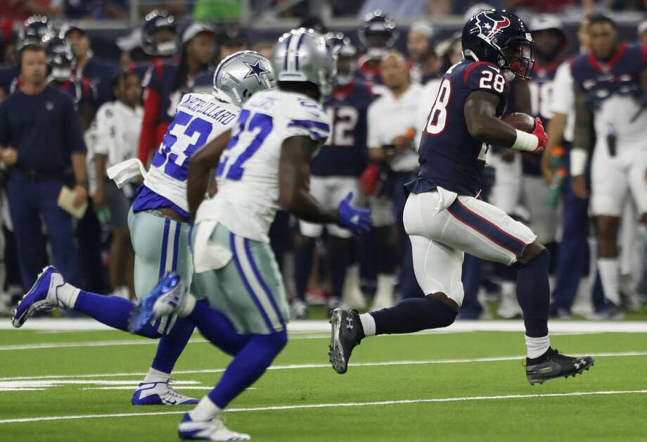 Houston Texans running back Alfred Blue (28) runs the ball with Dallas  Cowboys linebacker 56d1566ae