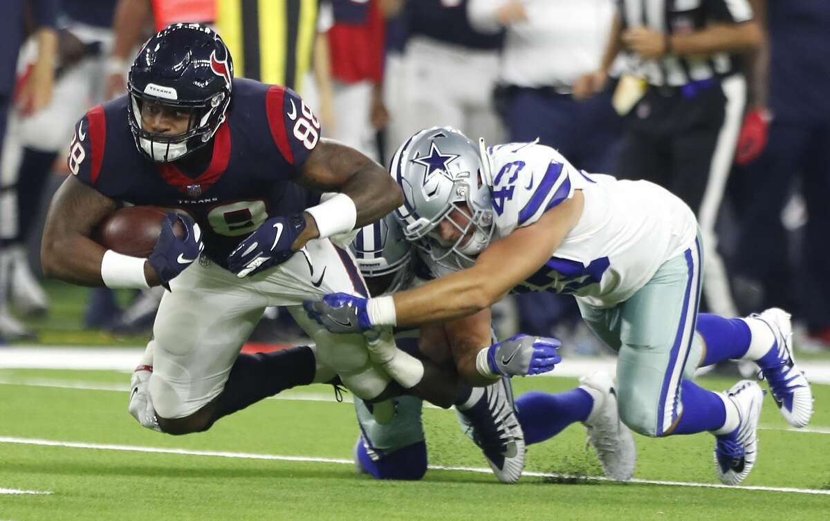 Houston Texans tight end Jordan Akins (88) is brought down by Dallas Cowboys linebacker Joel Lanning (43) for a first down reception during the second quarter of an NFL preseason football game between the Houston Texans and the Dallas Cowboys at NRG Stadium on Thursday, Aug. 30, 2018, in Houston.