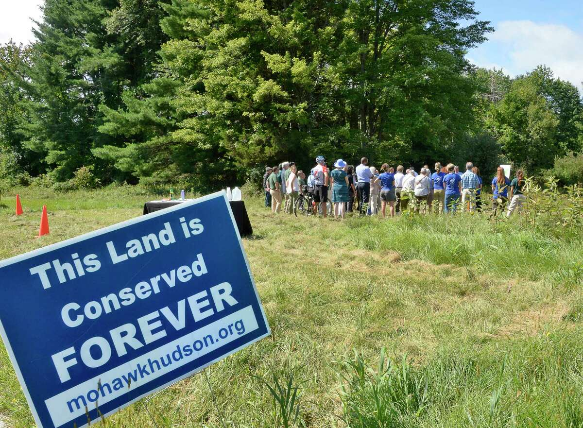 Staff, volunteers, Friends of Five Rivers and members gather for the announcement of a land acquisition for the Capital Region Thursday August 30, 2018 in Bethlehem, NY. The property is being incorporated into DEC?'s Five Rivers Environmental Education Center. (John Carl D'Annibale/Times Union)