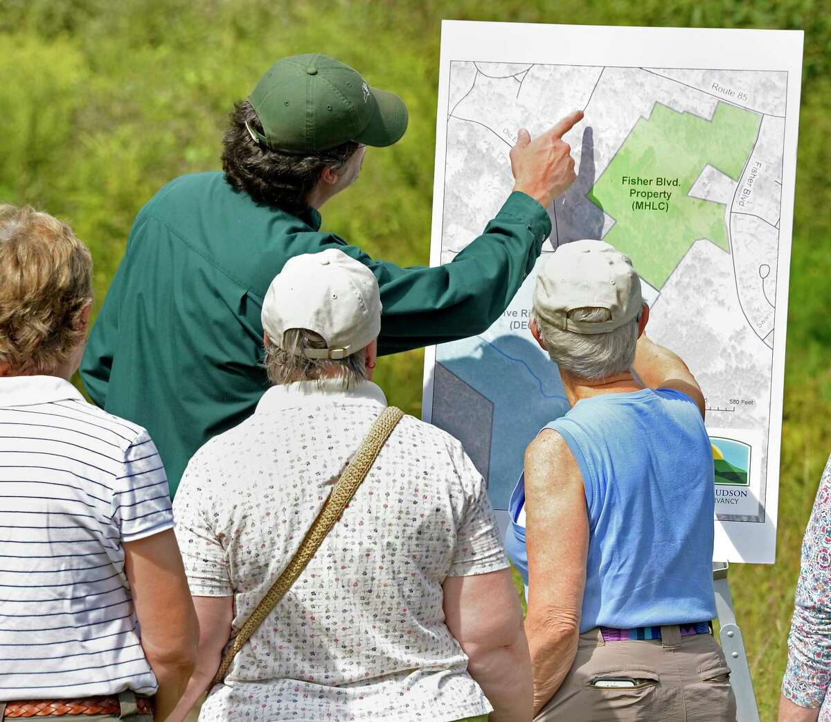 Staff, volunteers, Friends of Five Rivers and members look over a trail map during the announcement of a land acquisition for the Capital Region Thursday August 30, 2018 in Bethlehem, NY. The property is being incorporated into DECOs Five Rivers Environmental Education Center. (John Carl D'Annibale/Times Union)