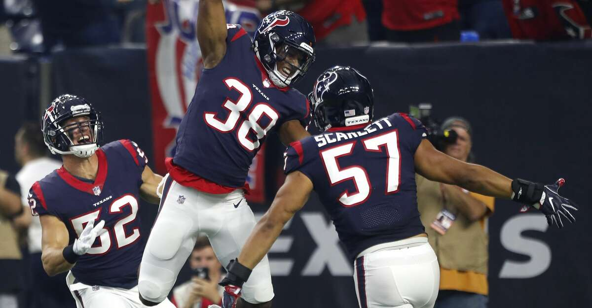 Houston Texans defensive back Justin Reid (38) celebrates his interception of a Dallas Cowboys quarterback Cooper Rush pass during the first quarter of an NFL preseason football game between the Houston Texans and the Dallas Cowboys at NRG Stadium on Thursday, Aug. 30, 2018, in Houston. Reid returned the intercepiton for a touchsdown, but he stepped out of bounds on the return and the play was called back.