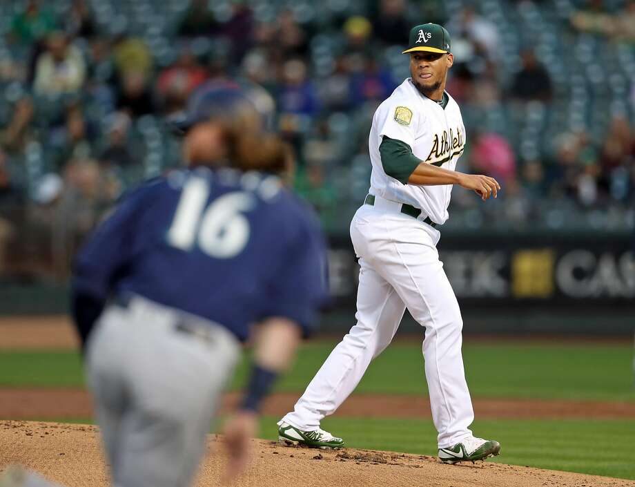 A's starting pitcher Frankie Montas watches an infield single by Seattle's Dee Gordon that drove in a run in the Mariners' five-run first inning. Montas became the first Oakland starter in nine games to complete six innings. Photo: Scott Strazzante / The Chronicle