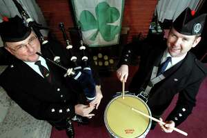 Times Union staff photo by Cindy Schultz  Bill Munro, left, blows the bagpipes, as his son Ian Munro, right, plays the drum Thursday, March 9, 2006, in Albany, N.Y. Their band, the Schenectady Pipe and Drum band, will perform during the St. Patrick's parade on Saturday in downtown Albany.