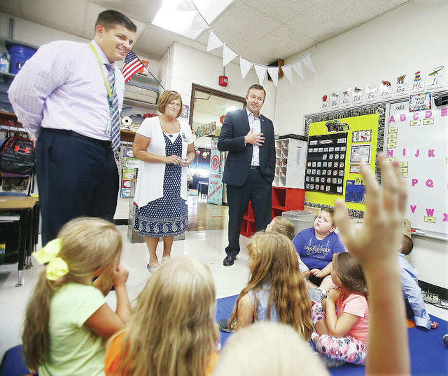 Sen. Andy Manar, D-Bunker Hill, right, visits a first-grade classroom Thursday at Brighton North Elementary School with school principal, Diane Milnor, center, and Southwestern School District Superintendent Brad Skertich, left. Manar Photo: John Badman |The Telegraph