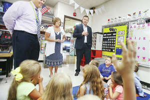 Sen. Andy Manar, D-Bunker Hill, right, visits a first-grade classroom Thursday at Brighton North Elementary School with school principal, Diane Milnor, center, and Southwestern School District Superintendent Brad Skertich, left.   Manar