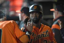SAN FRANCISCO, CA - JUNE 22:  Andrew McCutchen #22 of the San Francisco Giants is congratulated by teammates after he scored against the San Diego Padres in the bottom of the seventh inning at AT&T Park on June 22, 2018 in San Francisco, California.  (Photo by Thearon W. Henderson/Getty Images)