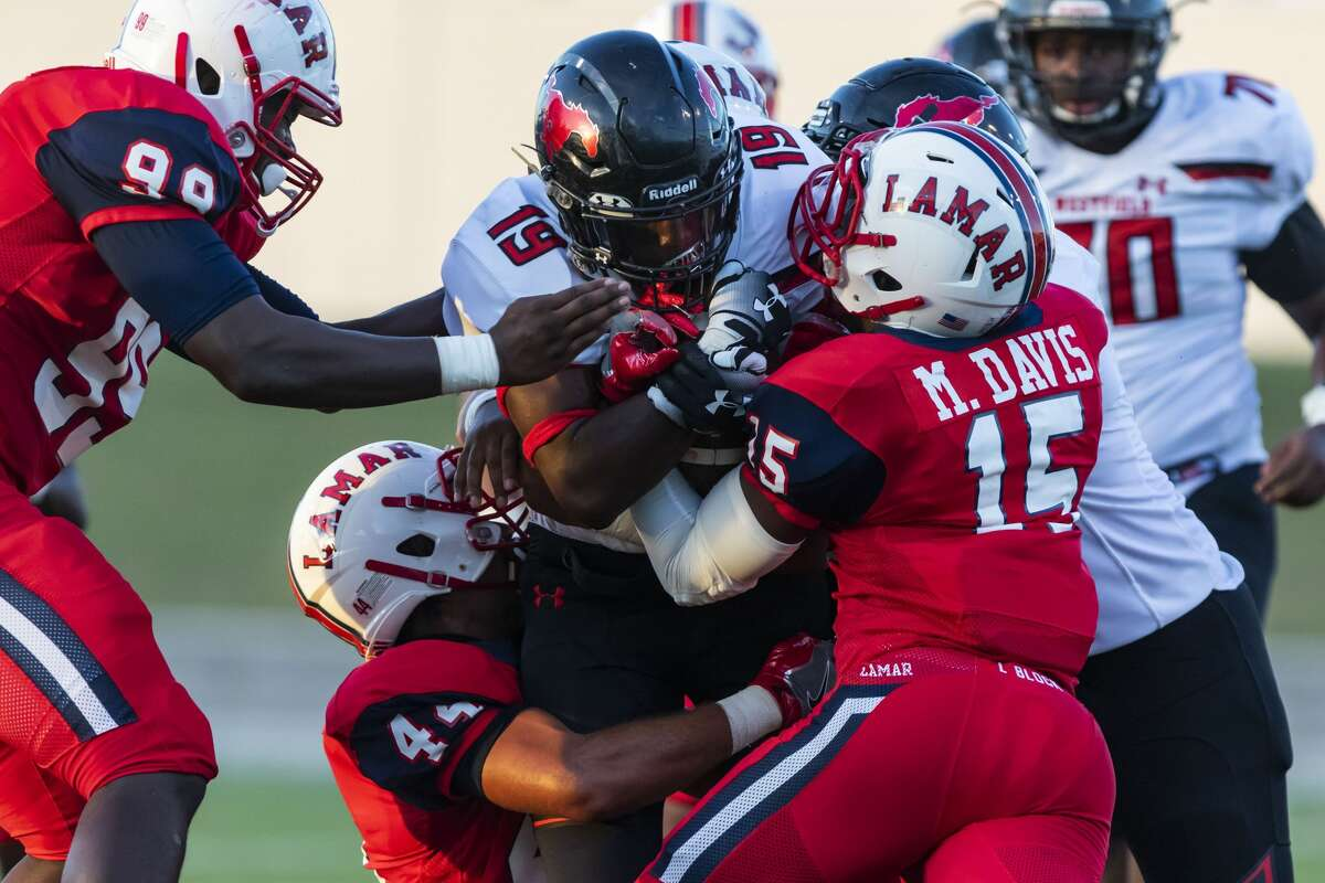 Westfield 31, Lamar 14 Westfield running back Joshua Adams (19) is tackled at the line of scrimmage by Lamar defensive back Mike Davis (15) in a high school football game at Delmar Stadium on Thursday, Aug 30, 2018, in Houston.