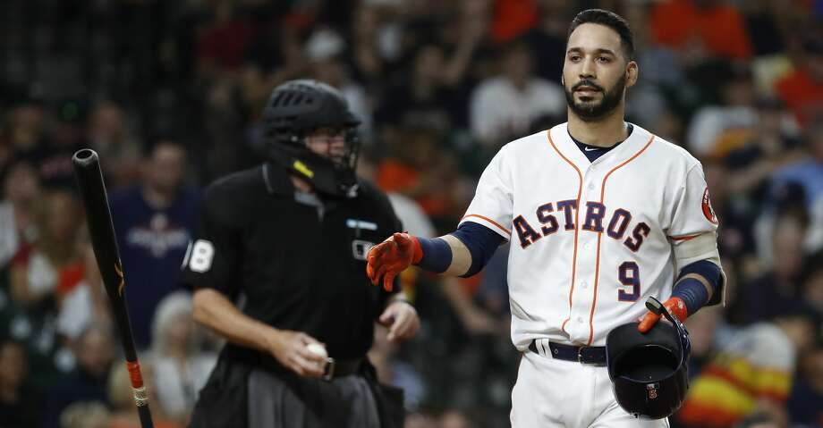 Houston Astros Marwin Gonzalez (9) tosses his bat after striking out during the fifth inning of an MLB baseball game at Minute Maid Park, Thursday,  August 30, 2018, in Houston. Photo: Karen Warren/Staff Photographer