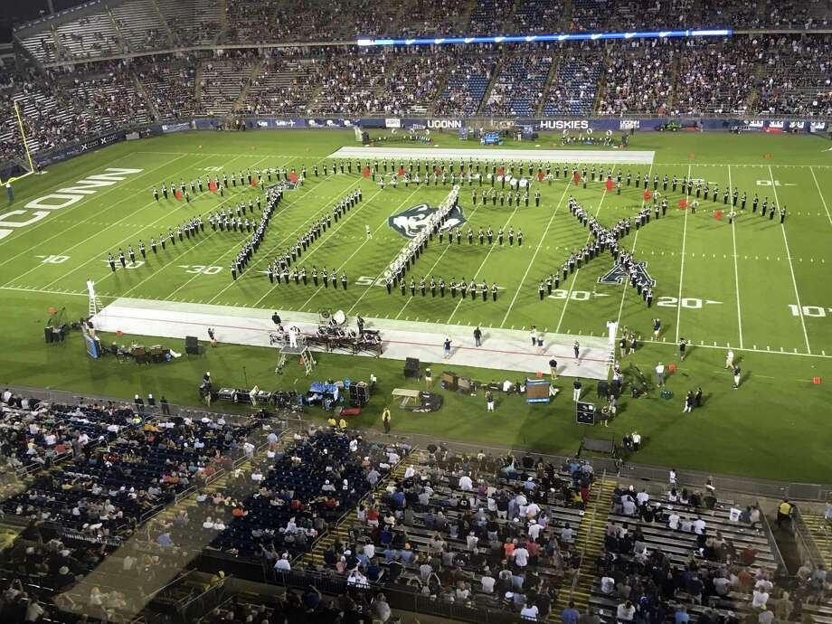 "Alex Schachter, who was killed in the February shooting at Marjory Stoneman Douglas High School, is honored by the Connecticut marching band, which spelled out the word ""Alex"" during its halftime show on Thursday. Photo: Stephen Dunn / Associated Press / Copyright 2018 The Associated Press. All rights reserved"