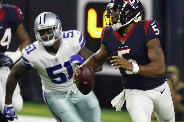 Texans backup quarterback Joe Webb rolls out to buy time for his receivers to get open.