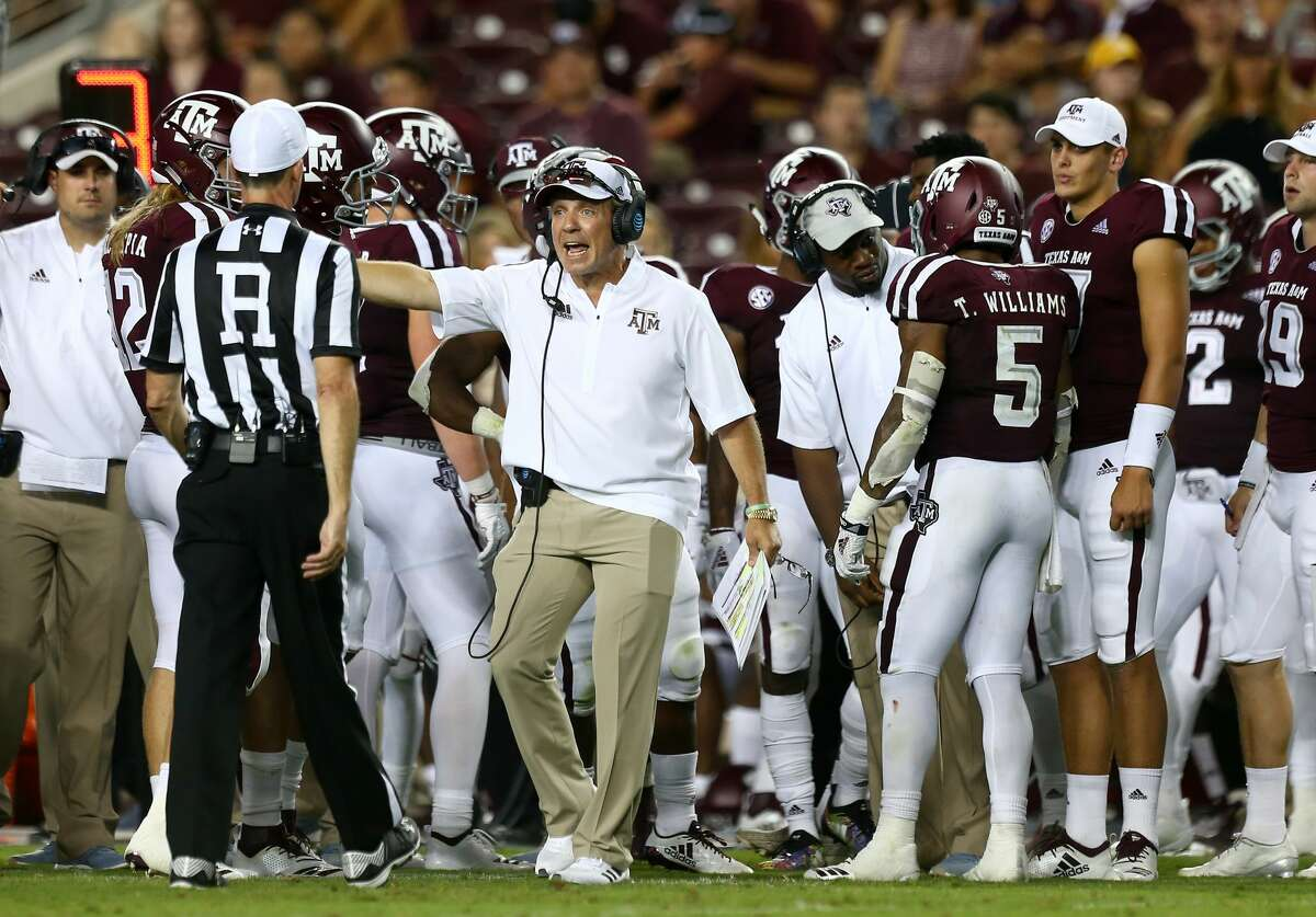 Texas A&M Aggies head coach Jimbo Fisher talks to a referee during the second quarter of the NCAA game against the Northwestern State Demons at Kyle Stadium Thursday, Aug. 30, 2018, in College Station, Texas.