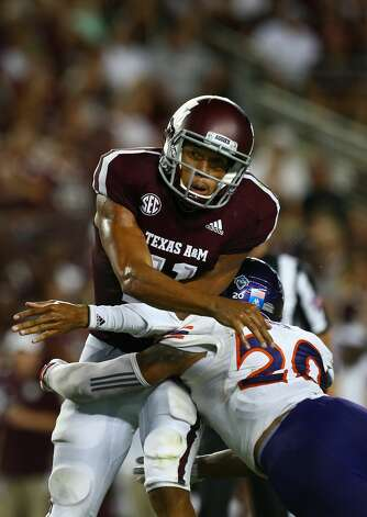 Texas A&M Aggies quarterback Kellen Mond (11) is hit Northwestern State Demons cornerback Dylan Wilson (28) after throwing the ball during the second quarter of the NCAA game at Kyle Stadium Thursday, Aug. 30, 2018, in College Station, Texas. Photo: Godofredo A. Vasquez/Staff Photographer