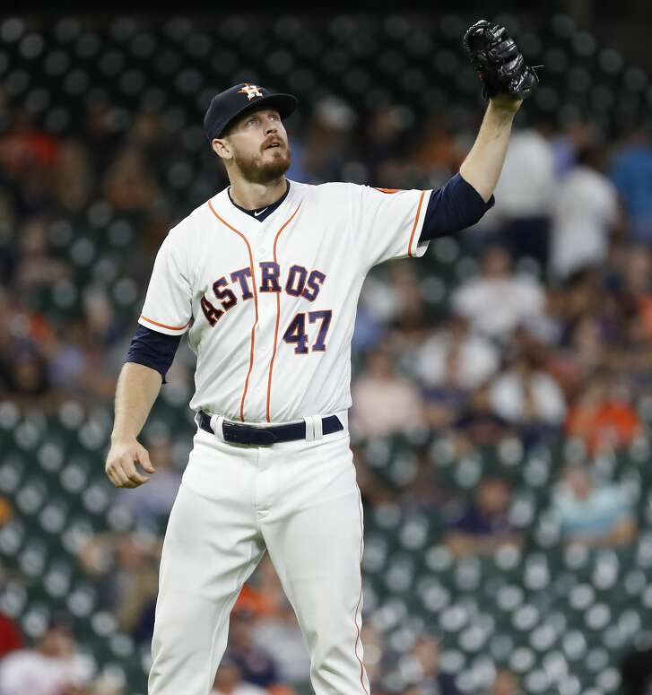 Houston Astros relief pitcher Chris Devenski (47) between pitches during the eighth inning of an MLB baseball game at Minute Maid Park, Thursday,  August 30, 2018, in Houston.