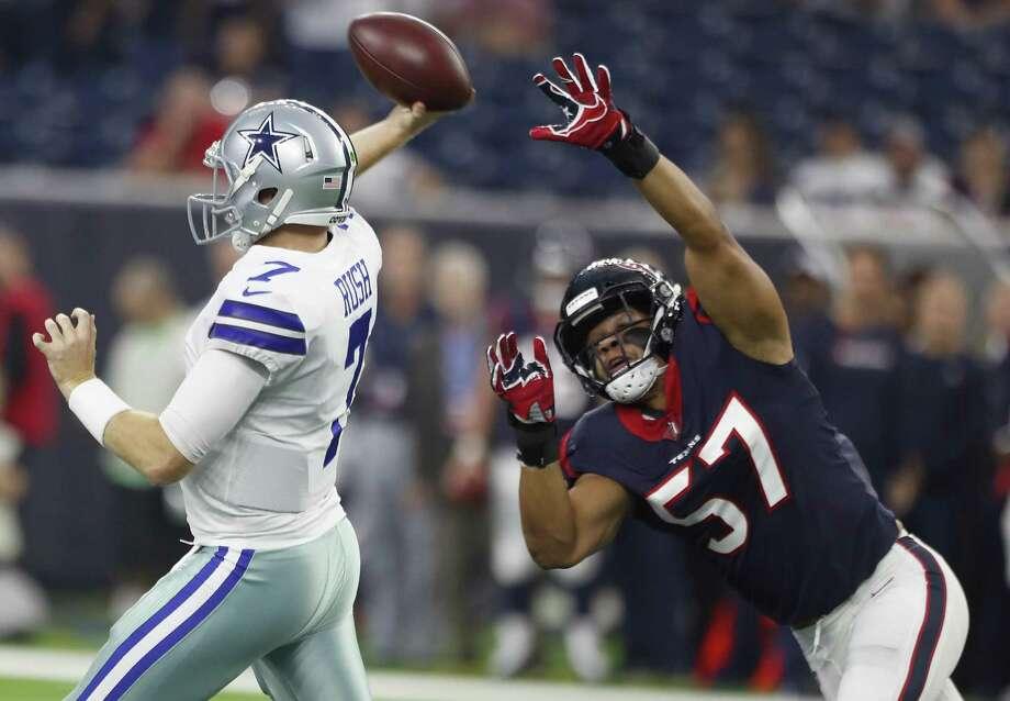 Cowboys quarterback Cooper Rush throws as he's pressured by Texans linebacker Brennan Scarlett. Photo: Brett Coomer /Staff Photographer / © 2018 Houston Chronicle