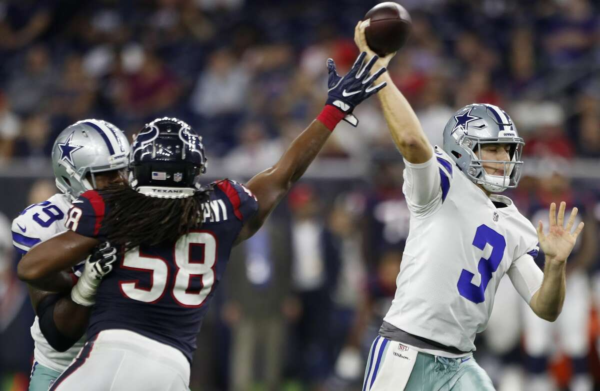 Dallas Cowboys quarterback Mike White (3) throws a pass as Houston Texans linebacker Peter Kalambayi (58) puts on the pressure during the fourth quarter of an NFL preseason football game betweenat NRG Stadium on Thursday, Aug. 30, 2018, in Houston.