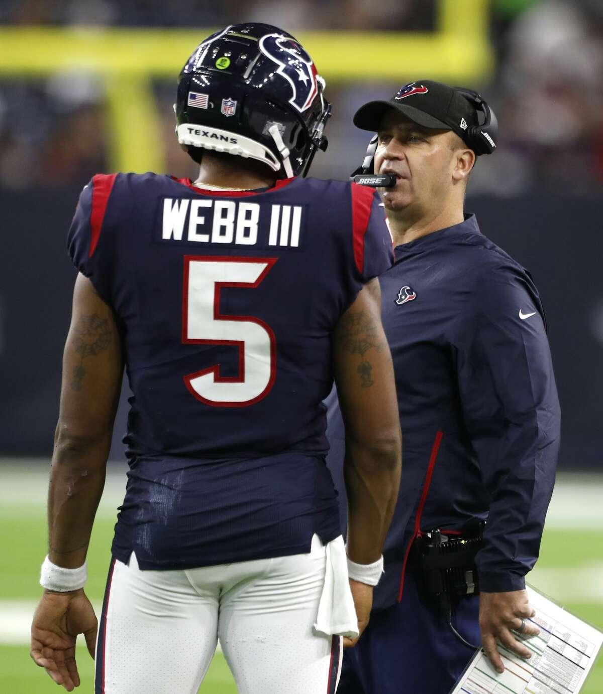 Houston Texans head coach Bill O'Brien talks to quarterback Joe Webb (5) during the fourth quarter of an NFL preseason football game against the Dallas Cowboys at NRG Stadiumon Thursday, Aug. 30, 2018, in Houston.