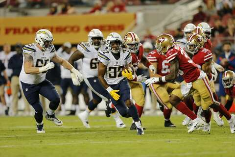 a7a255f2f Los Angeles Chargers running back Justin Jackson (32) evades defenders for  a long gain