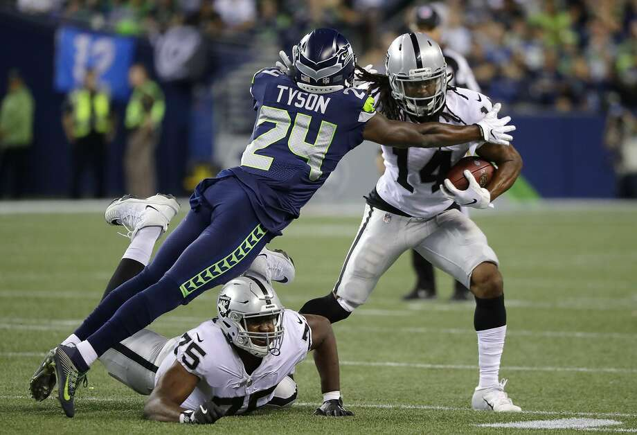 Seattle Seahawks defensive back Mike Tyson (24) tackles Oakland Raiders wide receiver Keon Hatcher, right, as Raiders offensive tackle Brandon Parker (75) watches during the second half of an NFL football preseason game, Thursday, Aug. 30, 2018, in Seattle. (AP Photo/Elaine Thompson) Photo: Elaine Thompson / Associated Press