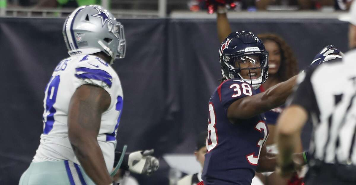 Houston Texans defensive back Justin Reid (38) returns an interception of a Dallas Cowboys quarterback Cooper Rush pass during the first quarter of an NFL preseason football game between the Houston Texans and the Dallas Cowboys at NRG Stadium on Thursday, Aug. 30, 2018, in Houston. Reid stepped out of bounds on the return.