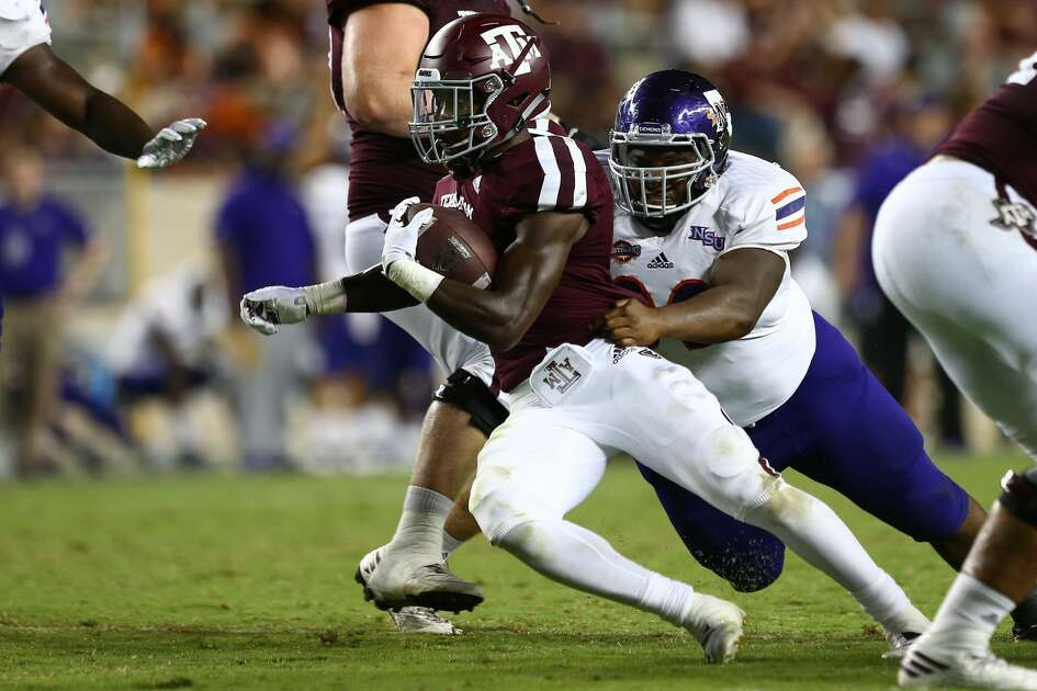 Texas A&M Aggies running back Jashaun Corbin (7) ashes the ball against the Northwestern State Demons during the fourth quarter of the NCAA game at Kyle Stadium Thursday, Aug. 30, 2018, in College Station, Texas.