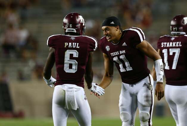 Texas A&M Aggies quarterback Kellen Mond (11) greets  wide receiver Roshauud Paul (6) on the sideline during the fourth quarter of the NCAA game against the Northwestern State Demons at Kyle Stadium Thursday, Aug. 30, 2018, in College Station, Texas. Photo: Godofredo A. Vasquez/Staff Photographer