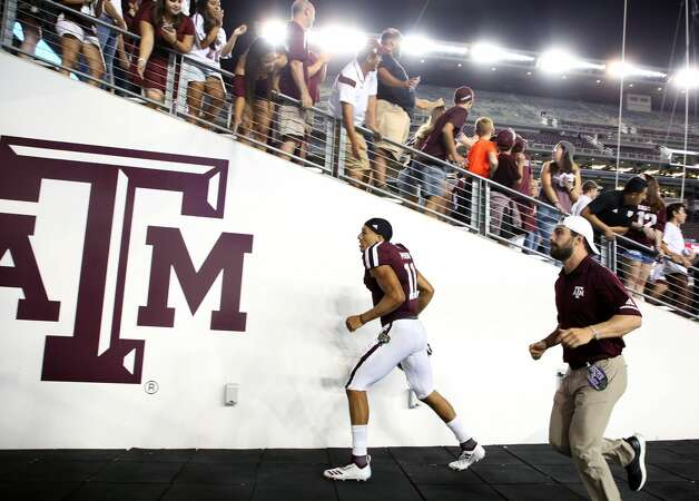 Texas A&M Aggies quarterback Kellen Mond (11) exits the field after the NCAA game against the Northwestern State Demons at Kyle Field Thursday, Aug. 30, 2018, in College Station, Texas. The Aggies won 59-7. Photo: Godofredo A. Vasquez/Staff Photographer