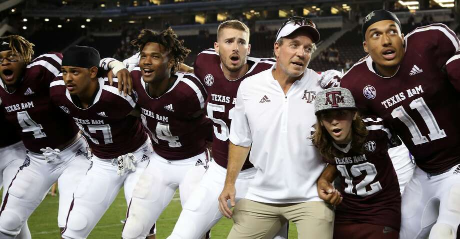 PHOTOS: Highest-paid college football coaches in the country Texas A&M Aggies head coach Jimbo Fisher along with players sing and say the Aggie War Hymm after defeating Northwestern State 59-7 at Kyle Field Thursday, Aug. 30, 2018, in College Station, Texas. Check out the photos for a look at the highest-paid college football coaches in the country. Photo: Godofredo A. Vasquez/Staff Photographer