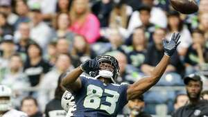 A ball sails above Seahawks wide receiver David Moore during the Seahawks final preseason game against the Oakland Raiders, Thursday, Aug. 30, 2018 at CenturyLink Field.