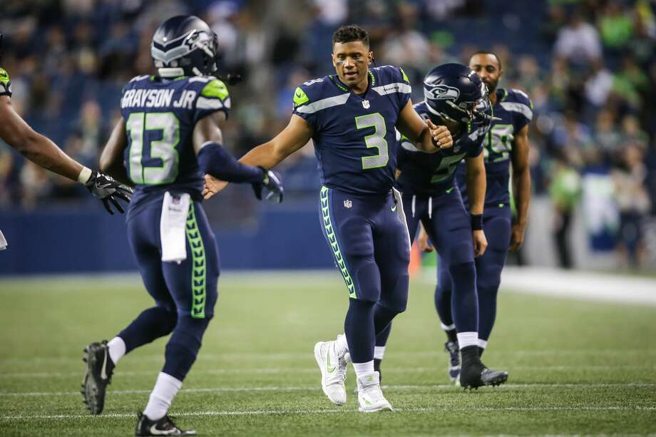 QUARTERBACKS (2)  KEEP: Russell Wilson, Brett Hundley  CUT: Austin Davis, Alex McGough   ARGUMENT: Wilson, one of the best quarterbacks in the NFL, is the undisputed starter. The Seahawks gave up a future sixth-round pick for Hundley, a proven backup (started for the Green Bay Packers last season when Aaron Rodgers was injured), so he's the No. 2 signal caller.  The hope here for the Seahawks is that McGough goes unclaimed off waivers so they can sign him to the practice squad.  Davis likely showed enough in the preseason finale (13-20, 194 yards, TD) to get picked up by another team before the regular season. Photo: Genna Martin, SeattlePI
