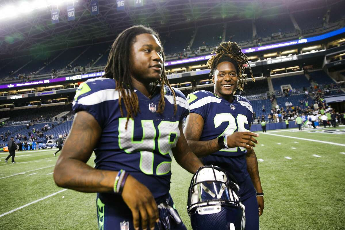 Seahawks linebacker Shaquem Griffin (49) and his twin brother corner back Shaquill Griffin (26) walk off field after the Seahawks final preseason game against the Oakland Raiders, Thursday, Aug. 30, 2018 at CenturyLink Field. (Genna Martin, seattlepi.com)