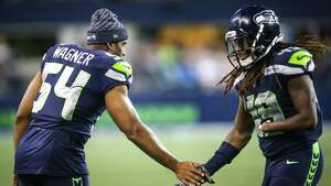 Bobby Wagner (54) greets Seahawks linebacker Shaquem Griffin as he comes off the field during the Seahawks final preseason game against the Oakland Raiders, Thursday, Aug. 30, 2018 at CenturyLink Field.