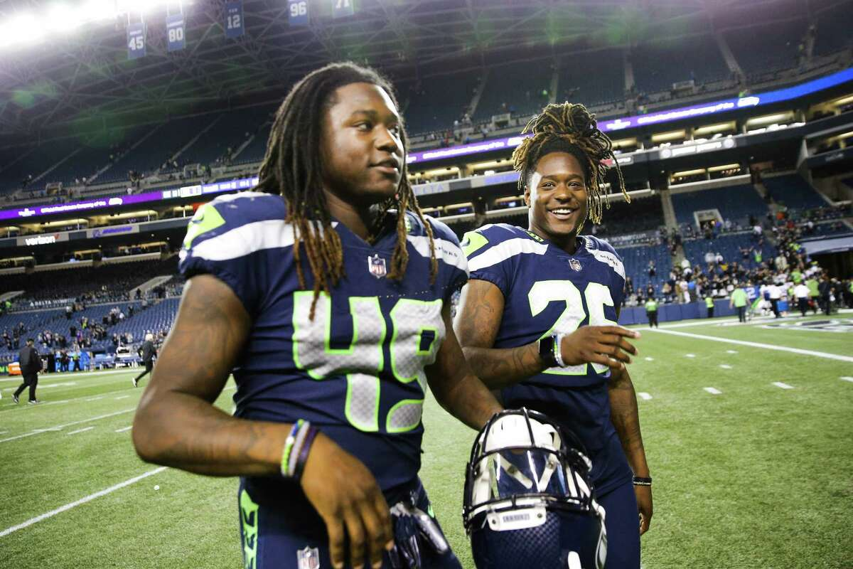 Seahawks linebacker Shaquem Griffin (49) and his twin brother corner back Shaquill Griffin (26) walk off field after the Seahawks final preseason game against the Oakland Raiders, Thursday, Aug. 30, 2018 at CenturyLink Field.