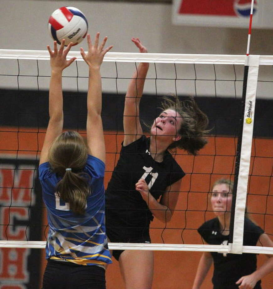 West Central's Lauren Sellars spikes the ball in a match against Pleasant Hill Monday in Meredosia. Photo: Dennis Mathes | Journal-Courier