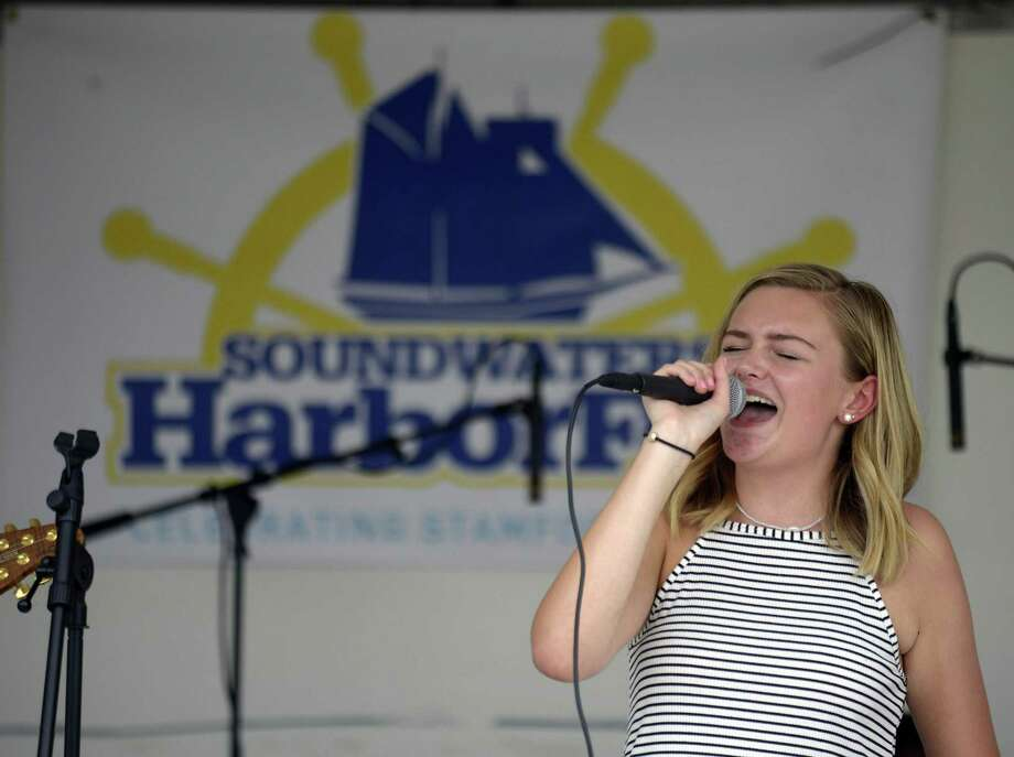 Perrin Trask of Darien, performs with other School of Rock New Canaan students during the third annual SoundWaters Harborfest on Aug. 25 in Stamford. Photo: Matthew Brown / Hearst Connecticut Media / Stamford Advocate