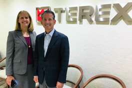 Westport Schools Superintendent Colleen Palmer, left, with Terex Corp. General Counsel Eric Cohen on Aug. 23 as Terex donated equipment to support Westport schools. The global machinery manufacturer, with corporate headquarters at Nyala Farms in Greens Farms, donated three 50-inch TV monitors, along with conference tables, office suites, chairs and other materials. Equipment is going principally to Bedford and Coleytown middle schools.