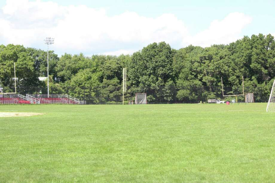 The turf field at Fairfield Warde High School will not be finished until the end of September, prompting school teams to use the grass fields and move games and practices to other schools. Photo: Genevieve Reilly / Hearst Connecticut Media / Fairfield Citizen