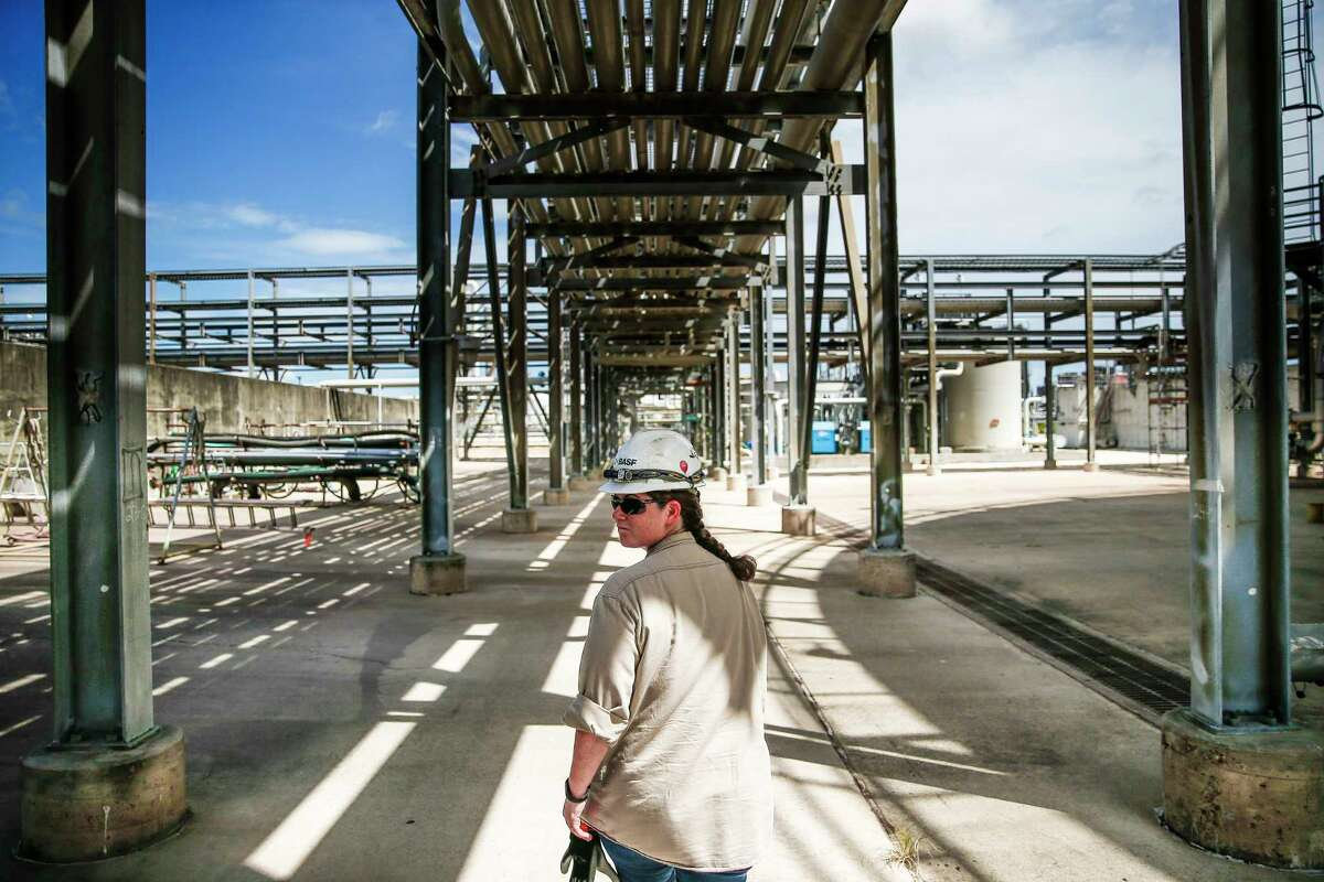 BASF instrument and electrical technician Rebecca Owen-Hamilton walks through the water treatment facility at BASF's petrochemical facility Thursday Aug. 30, 2018 in Freeport.