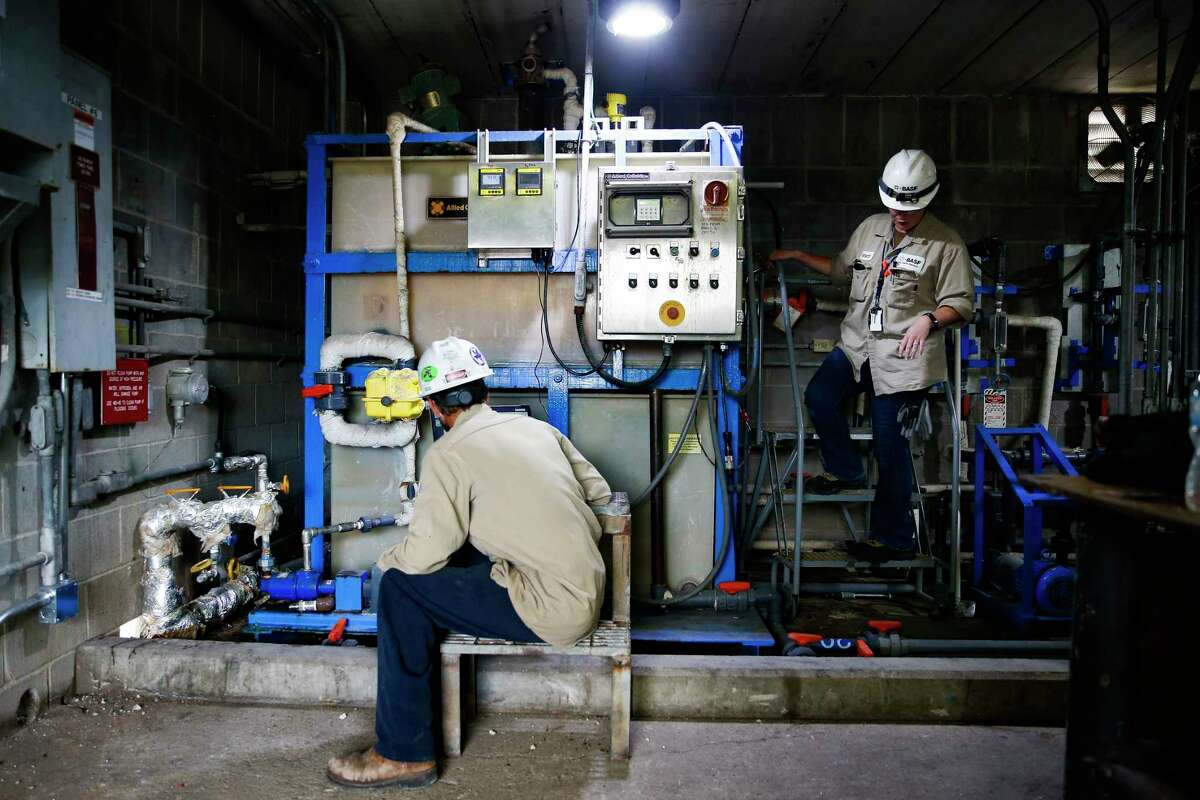 Senior instrument and electrical technician J.D. Wiginton, left, and BASF instrument and electrical technician Rebecca Owen-Hamilton work to upgrade a level transmitter at BASF's petrochemical facility Thursday Aug. 30, 2018 in Freeport.