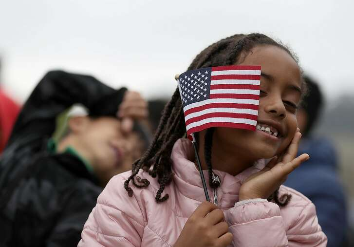 *** BESTPIX *** SAN FRANCISCO, CA - AUGUST 17:  Sophia Biniam, 7, holds an American flag during a naturalization ceremony for kids between the ages of 6-12 at Crissy Field near the Golden Gate Bridge on August 17, 2018 in San Francisco, California. Thirty-two children from seven countries were sworn in as U.S. citizens during a special naturalization ceremony.  (Photo by Justin Sullivan/Getty Images)
