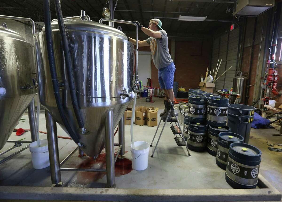 Co-owner Dustin Baker of Roadmap Brewing Co. cleans a brewing tank at the soon-to-open brewery located at 723 N. Alamo St. He will open San Antonio's newest brewery on Sept. 15.