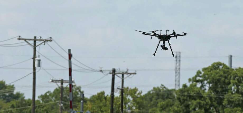 Eversource has begun employing drones to inspect electric lines in Connecticut, saying it will reduce costs and the impact on the environment caused by helicopters and trucks it uses. Photo: Ron Cortes / Ronald Cortes / Freelance