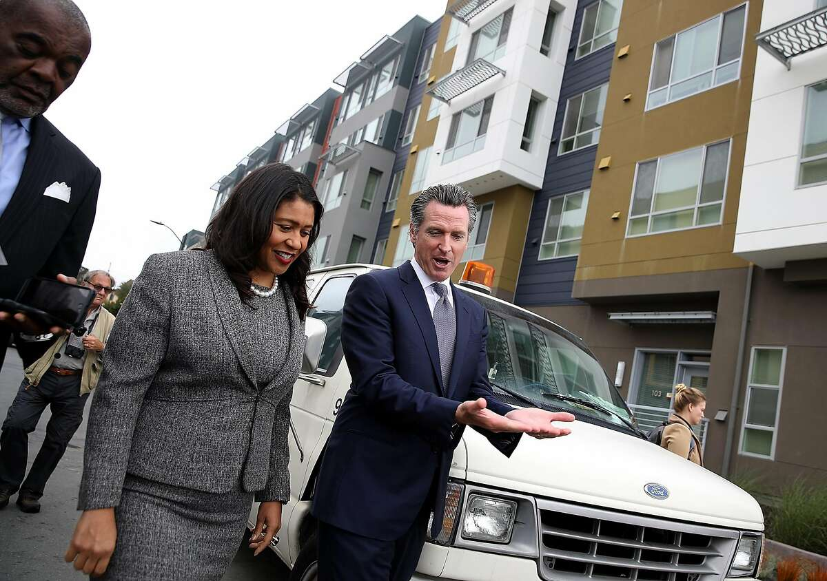 SAN FRANCISCO, CA - AUGUST 22: California Lt. Gov. and California gubernatorial candidate Gavin Newsom (R) talks with San Francisco mayor London Breed (L) as they visit the Alice Griffith Apartments on August 22, 2018 in San Francisco, California. Lt. Gov. Gavin Newsom and San Francisco mayor London Breed toured a low-income housing complex. Newsom leads Republican gubernatorial candidate John Cox by an average of 23 percentage points in recent polls. (Photo by Justin Sullivan/Getty Images)